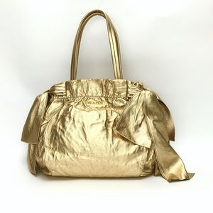 Authentic PRADA Gold Metallic Antic Bow Nappa Bag